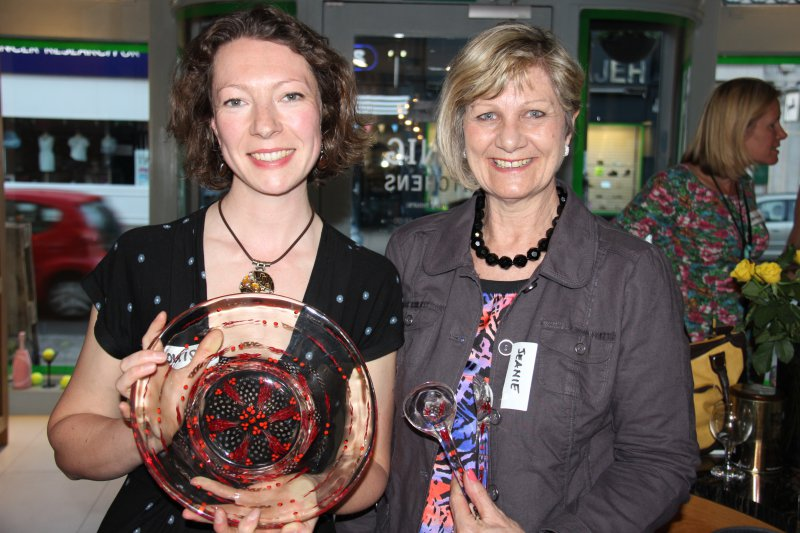 Malulu Director, Louise Edwards, displaying handmade resin salad bowl from Zimbabwe and Janie with her freshly purchased resin salad servers.